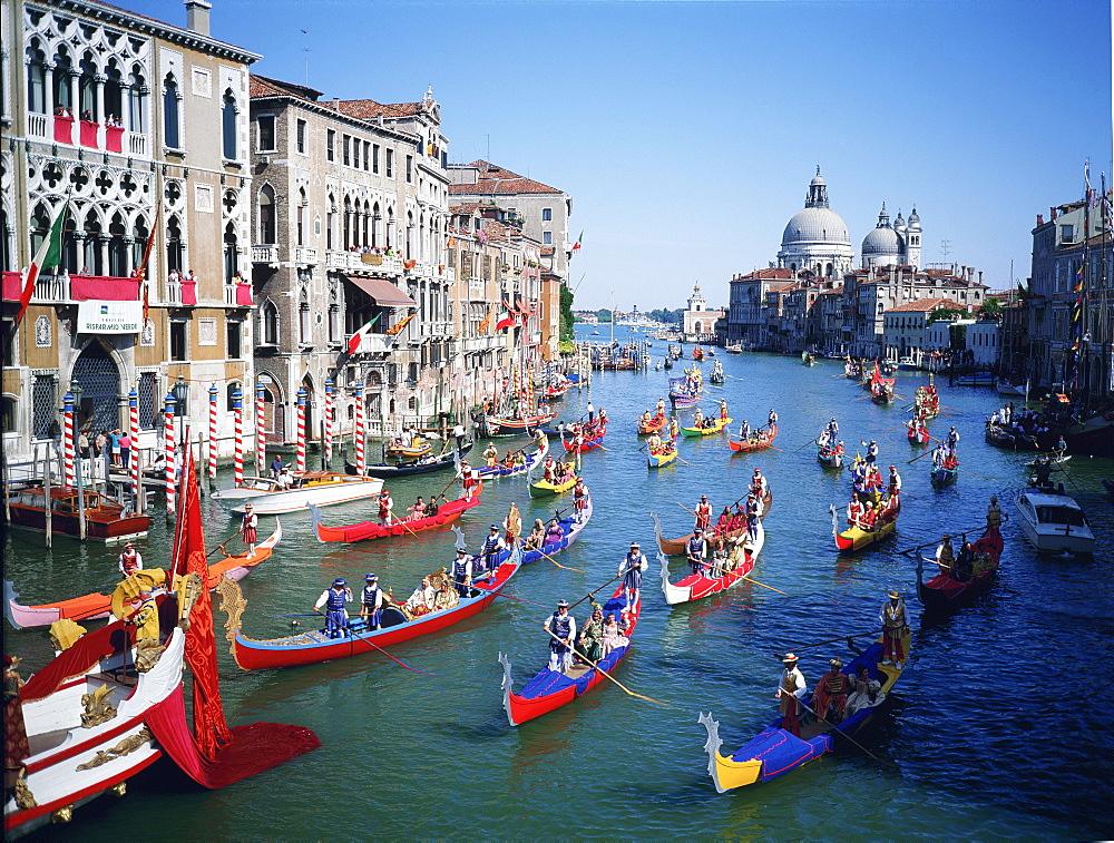 The Storica Regatta on the Grand Canal before the church of Santa Maria della Salute