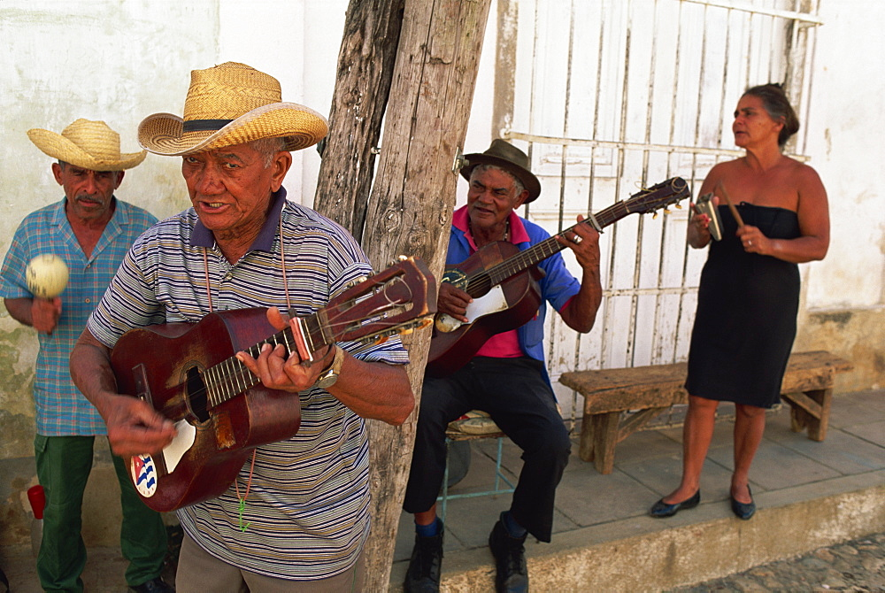 Group of three elderly men and a woman playing music, Trinidad, Cuba, West Indies, Central America