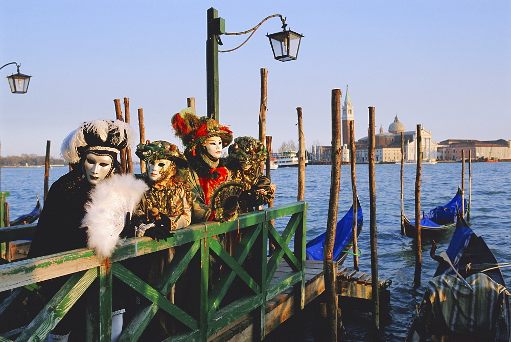 People wearing masked carnival costumes, San Giorgio in the background, Venice Carnival, Venice, Veneto, Italy