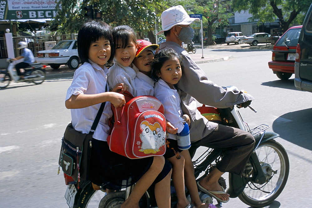 Children riding on a motor scooter, Phnom Penh, Cambodia, Indochina, Southeast Asia, Asia