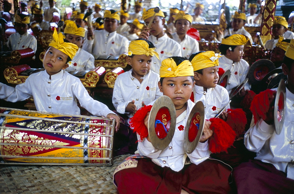 Child musicians at Odalan ceremony, temple of Bataun, island of Bali, Indonesia, Southeast Asia, Asia