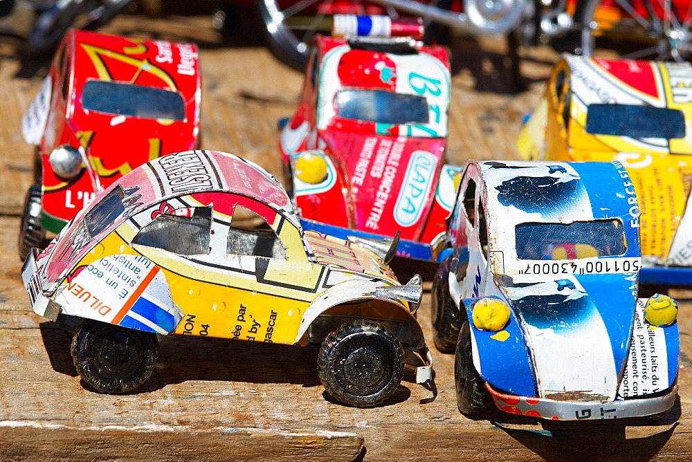 Toy cars made with metal food box and sold on the National 7 road, Madagascar, Africa