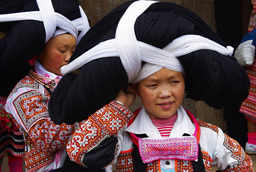 Long Horn Miao girls in traditional costumes celebrating Flower Dance Festival, Longjia village, Guizhou Province, China, Asia - 712-2602