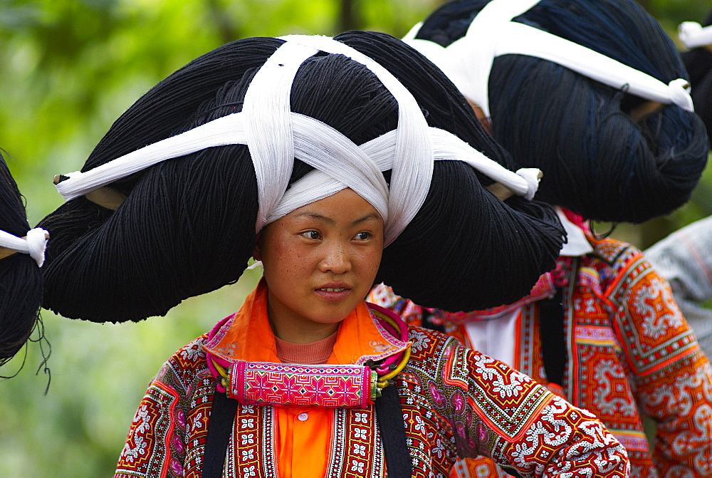 Long Horn Miao girls in traditional costumes celebrating Flower Dance Festival, Longjia village, Guizhou Province, China, Asia - 712-2604