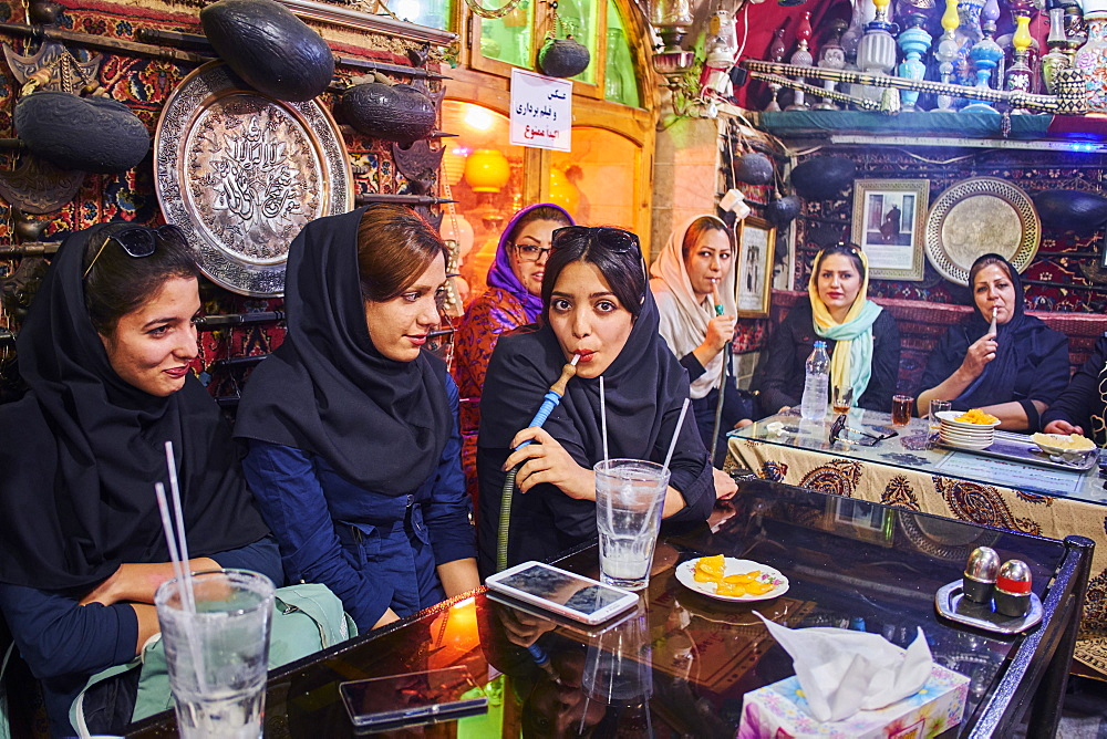Azadegan teahouse, young women smoking a water pipe, Isfahan, Iran, Middle East