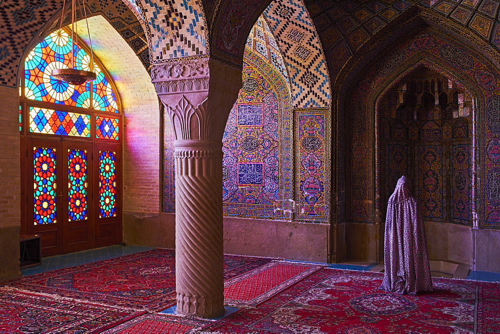 Iran, Fars Province, Shiraz, Nasir al Molk mosque, woman praying