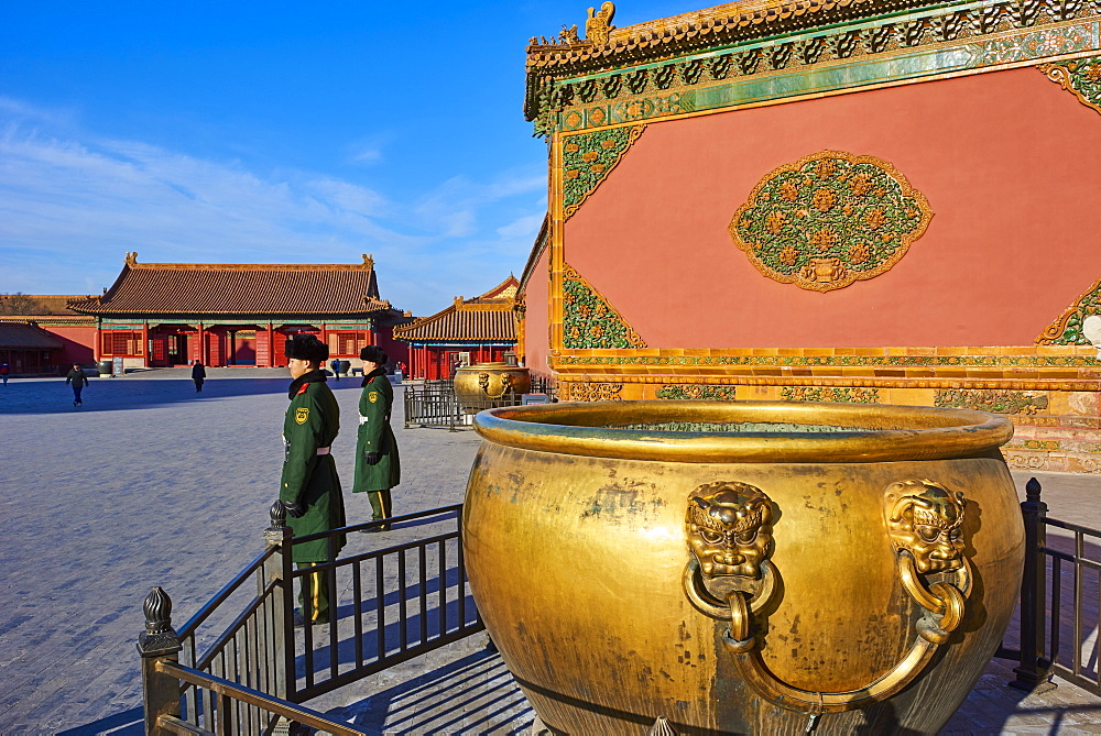 Golden cistern and security guards in the Forbidden City, Beijing, China