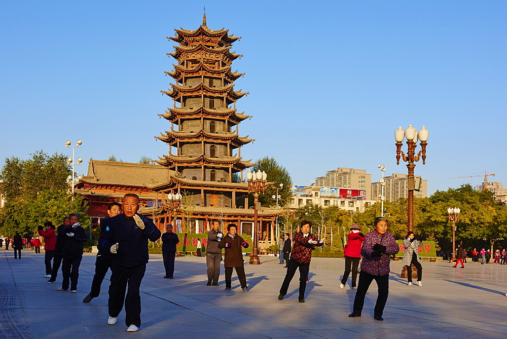 Morning exercises in front of the wooden pagoda on the main square, Zhangye, Gansu Province, China, Asia - 712-2935