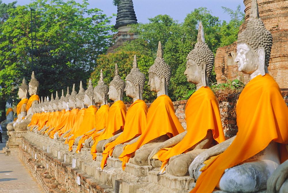 Line of seated Buddha statues, Wat Yai Chai Mongkon, Ayuthaya, Thailand
