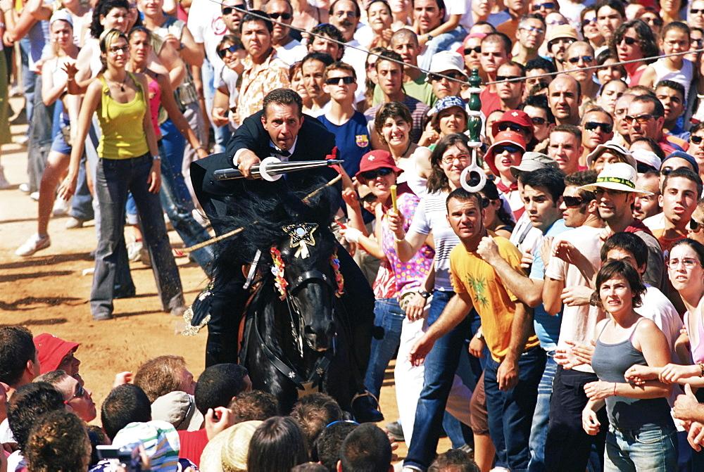 Rider speeding during the Medieval games, festival celebrated on St. John's Day (Festa de Sant Joan), Ciutadella, Minorca (Menorca), Balearic Islands, Spain, Mediterranean, Europe