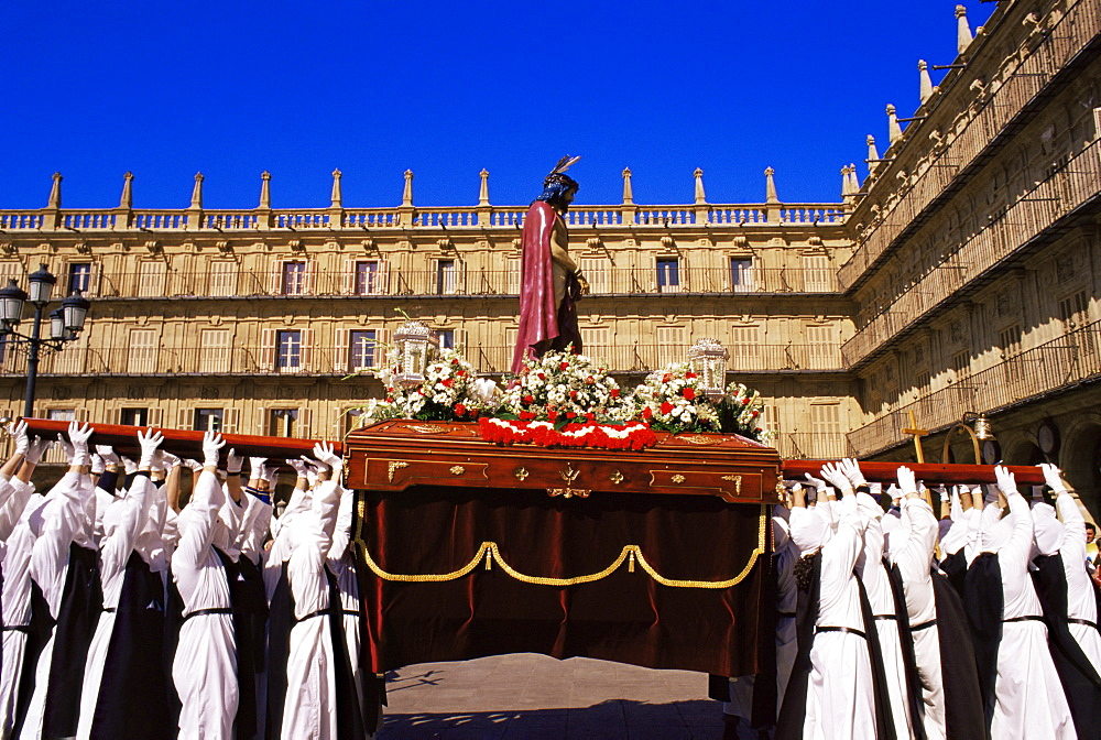 Penitents lifting the Jesus Christ carriage during Semana Santa (Holy Week) procession, Salamanca, Castilla y Leon (Old Castile), Spain, Europe