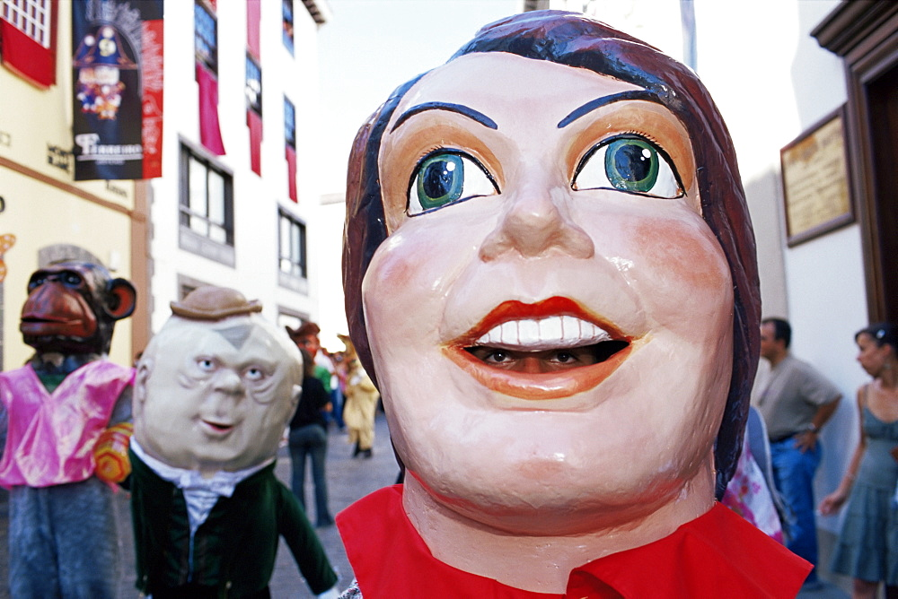 Giant masks on parade during celebration of Descent of Our Lady of Snows fiesta, Santa Cruz de la Palma, La Palma, Canary Islands, Spain, Atlantic, Europe - 718-1117
