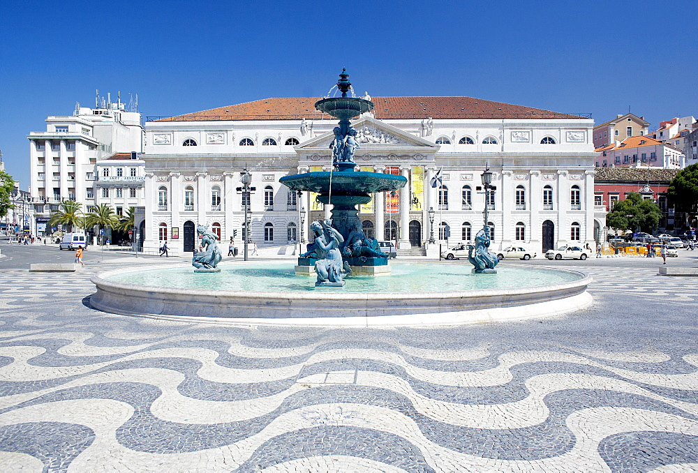 Mosaic paving and fountain with Lisbon Opera House in the background, Praca Dom Pedro IV (Rossio Square), Lisbon, Portugal, Europe