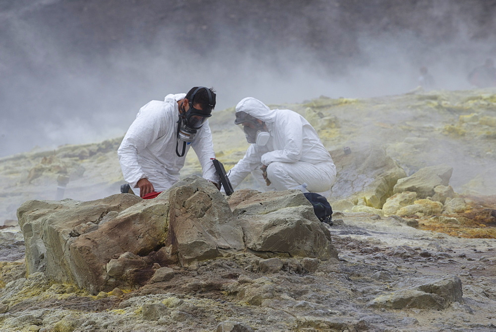 Geologists taking mineral samples on Gran Cratere (The Great Crater), Vulcano Island, Aeolian Islands, UNESCO World Heritage Site, Sicily, Italy, Mediterranean, Europe