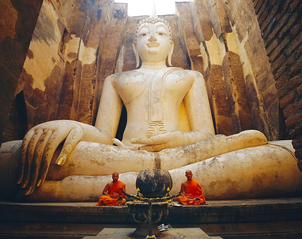 Seated Buddha and monks meditating, Wat Si Chum, Sukhothai Historical Park, Thailand - 718-309