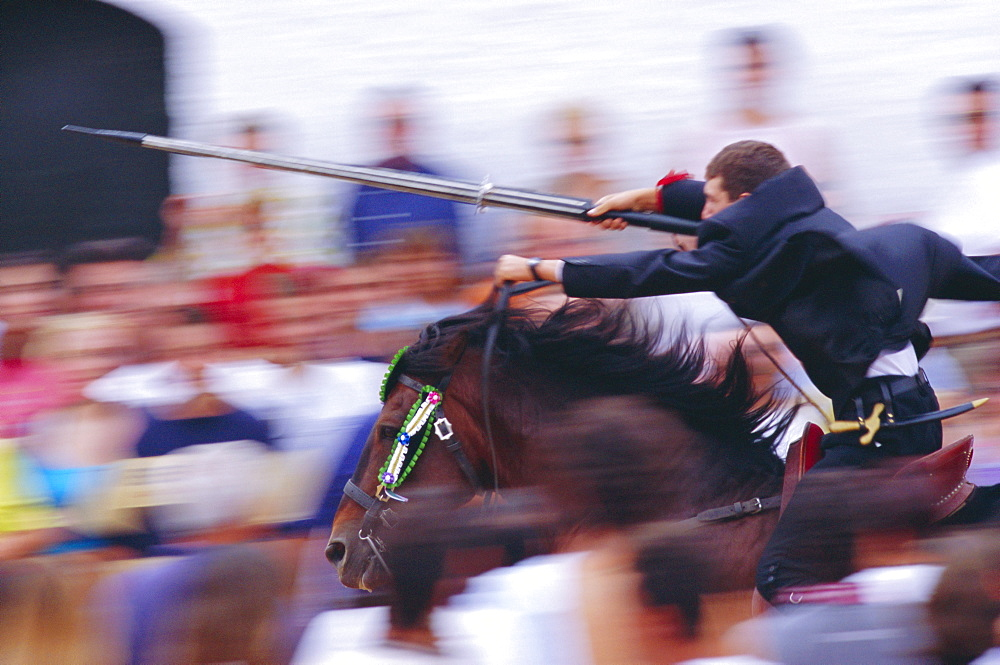 Horse rider jousting with target during the Sant Joan's festival, Ciutadella, Minorca, Spain
