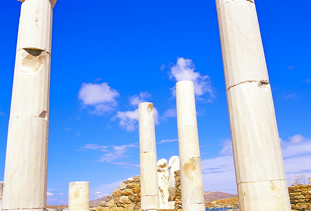 Columns surrounding ancient statues of Cleopatra and Diocrides, archaeological site of Delos, UNESCO World Heritage Site, Cyclades islands, Greece, Mediterranean, Europe