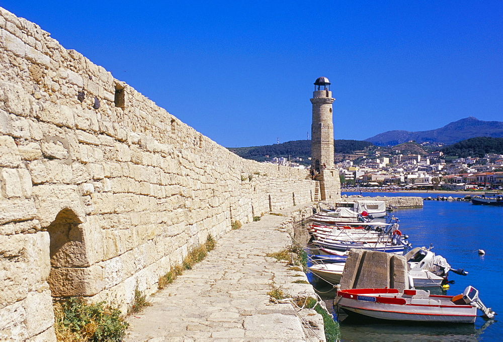 View of old Venetian Rethymo's lighthouse, wall and harbours, Rethymno (Rethymnon), island of Crete, Greece, Mediterraneann, Europe