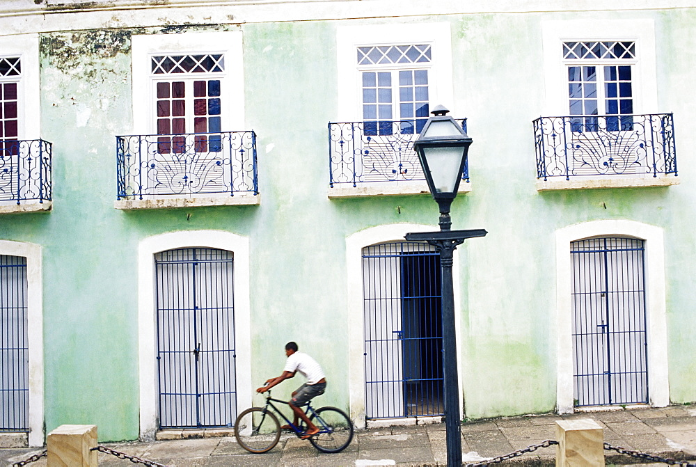 Man riding bicycle in front of old colonial house, Sao Luis, Maranhao, Brazil, South America - 718-779