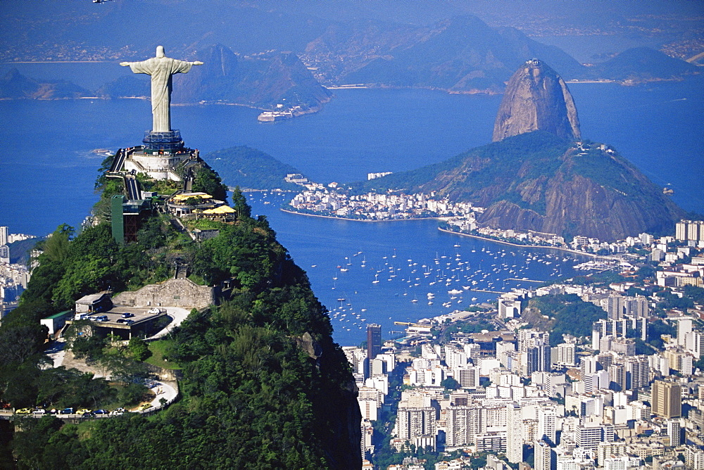 Statue of Christ the Redeemer overlooking city and Sugar Loaf mountain, Rio de Janeiro, Brazil, South America - 718-801