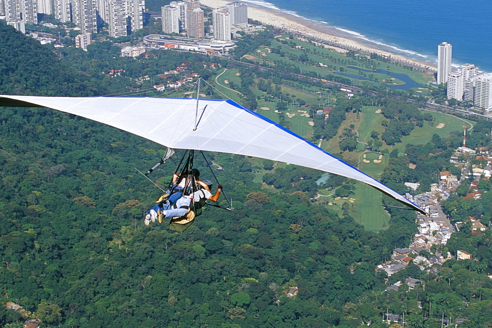 Hang-glider after taking off from Pedra Bonita, Rio de Janeiro, Brazil, South America