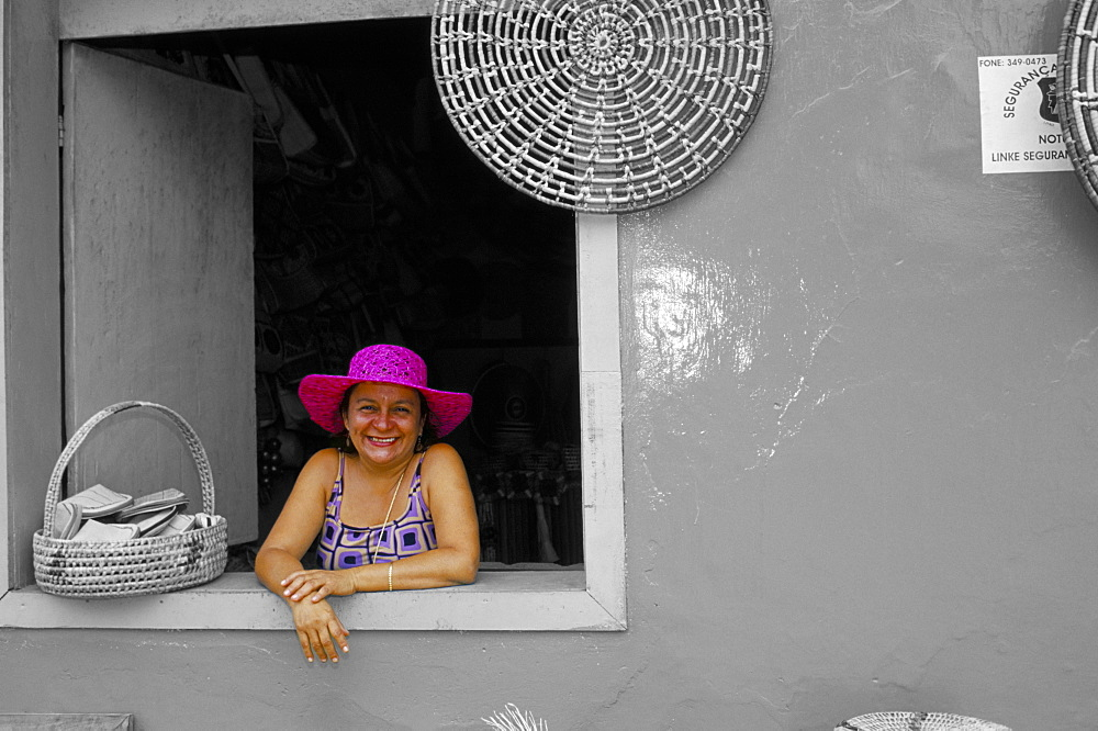 Hat seller at the window of her shop, Parque Nacional dos Lencois Maranhenses, Brazil, South America - 718-899B