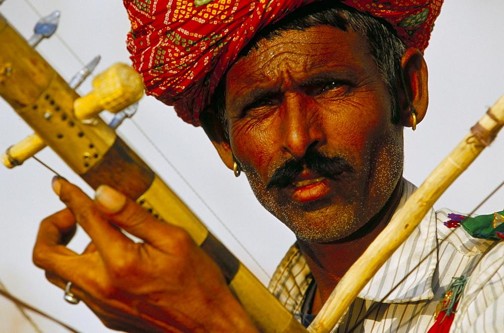 Portrait of a Rajasthani musician, Pushkar, Rajasthan state, India, Asia