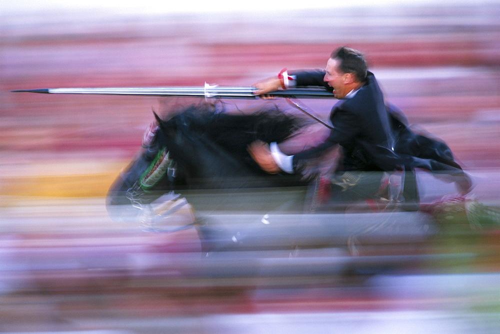 Rider speeding during the Medieval Games, festival celebrated on St. John's Day (Festa de Sant Joan), Ciutadella, Minorca (Menorca), Balearic Islands, Spain, Europe - 718-983