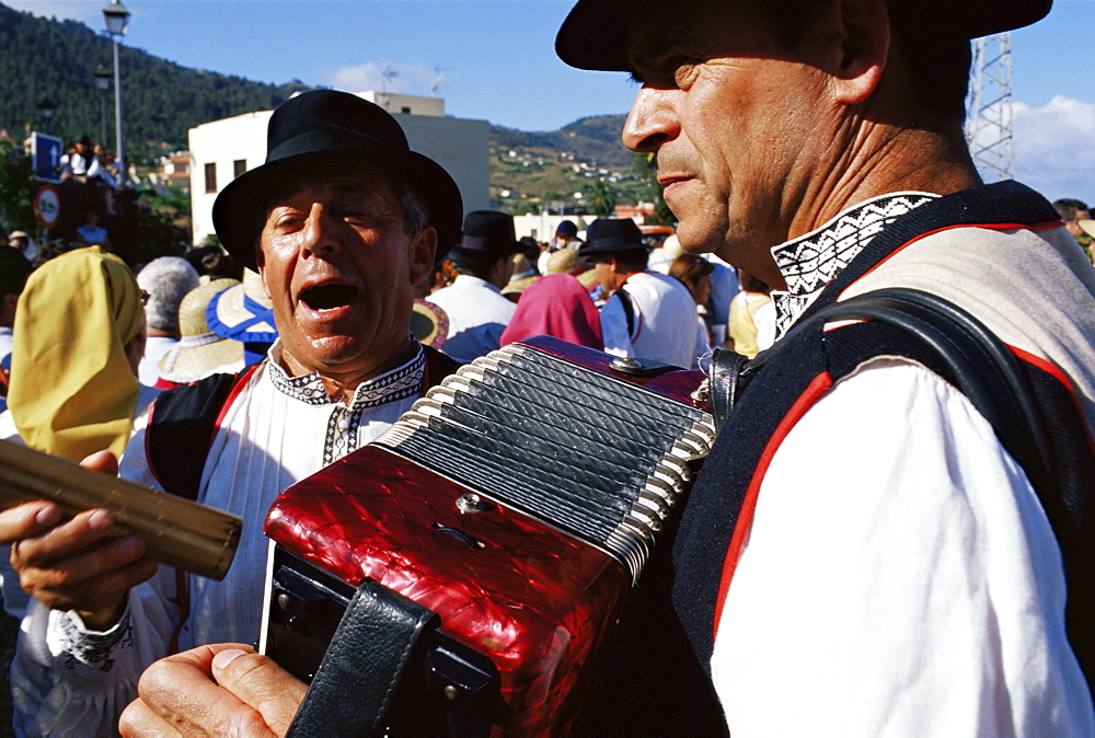 People traditionally dressed, singing during the Fiesta of the Descent of Our Lady of Snows, Santa Cruz de la Palma, La Palma, Canary Islands, Spain, Atlantic, Europe - 718-986