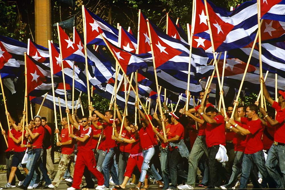 May Day marchers with Cuban flags, Plaza de la Revolucion, Havana, Cuba, West Indies, Central America - 722-119