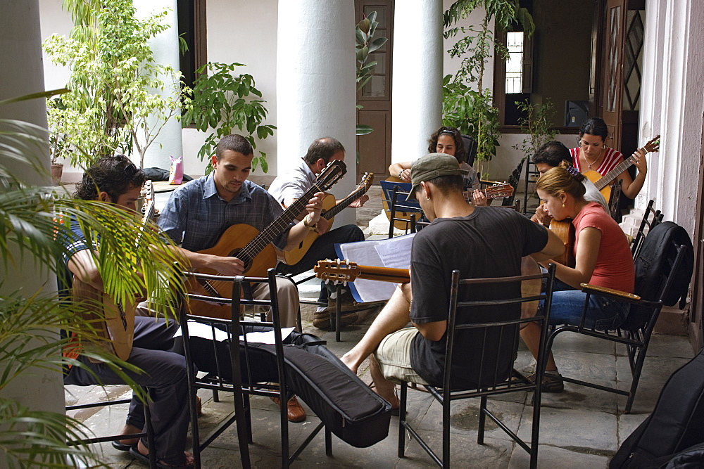 Young classical guitar musicians rehearsing in the inner courtyard, City Hall (Casa de la Ciudad), Santa Clara, Cuba, West Indies, Central America - 722-145