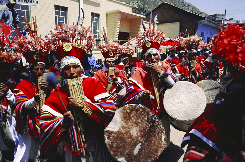 Musicians in bright costumes, Puno, Peru, South America