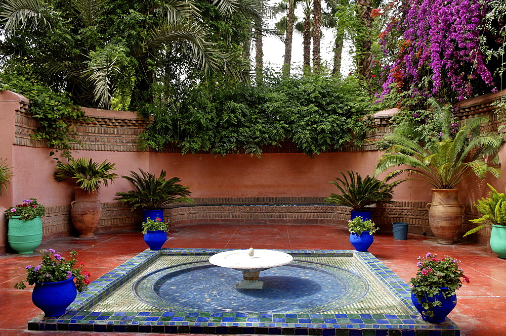 Fountain in the Majorelle Garden, created by the French cabinetmaker Louis Majorelle, and restored by the couturier Yves Saint-Laurent, Marrakesh, Morocco, North Africa, Africa