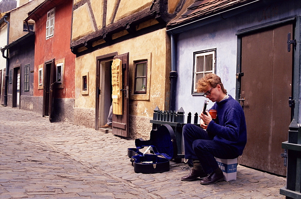 Musician busking in street, Prague Castle, Prague, Czech Republic, Europe