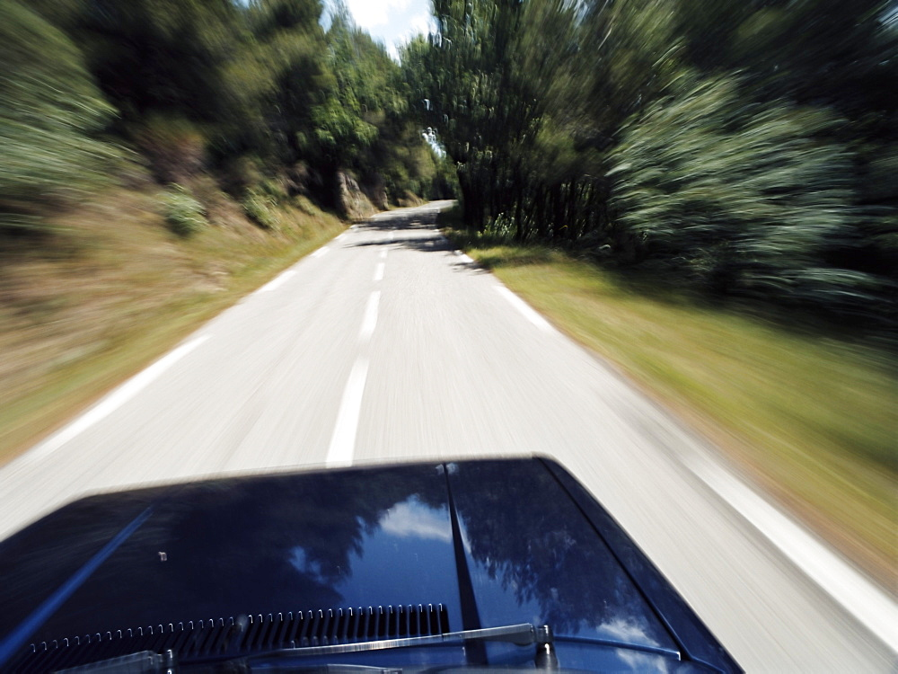 Car speeding on rural road near St. Tropez, Cote d'Azur, Provence, France, Europe