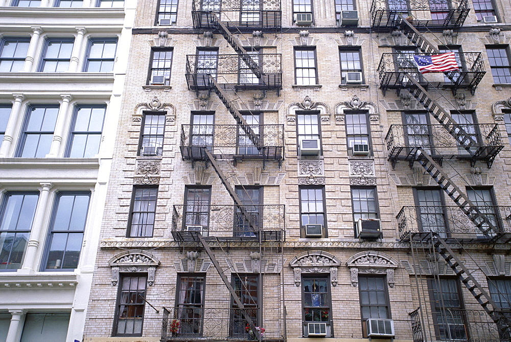 Building with fire escape stairways, Soho, New York, USA, North America