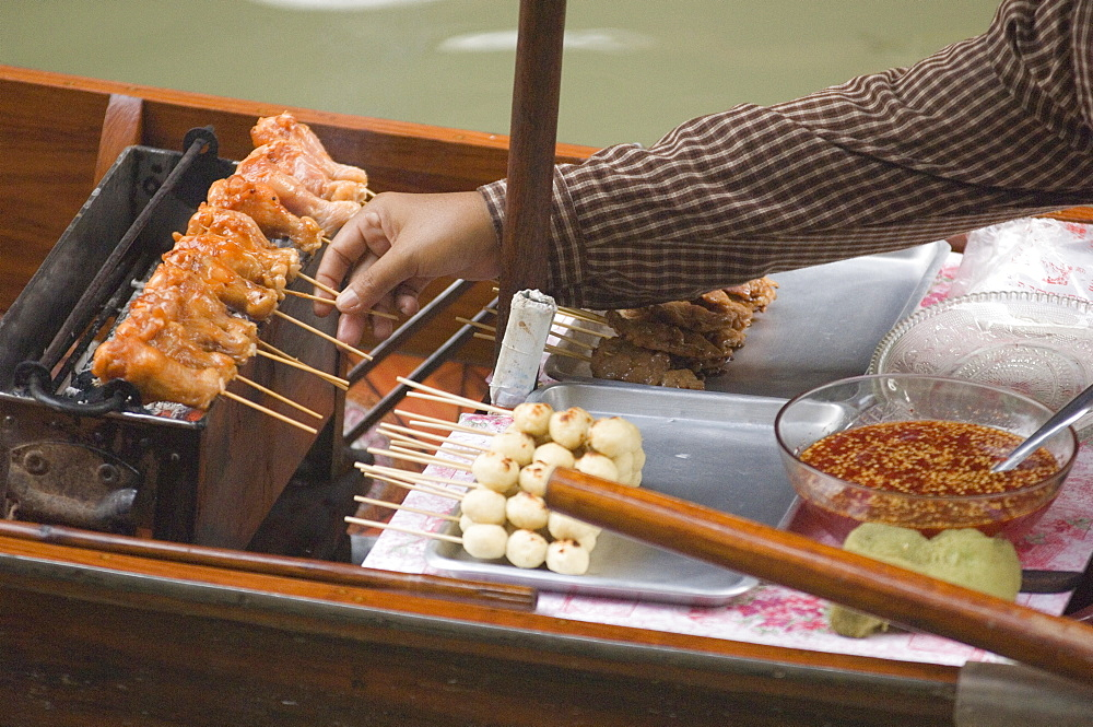 Food being cooked and sold on a boat, Floating Market, Bangkok, Thailand, Asia