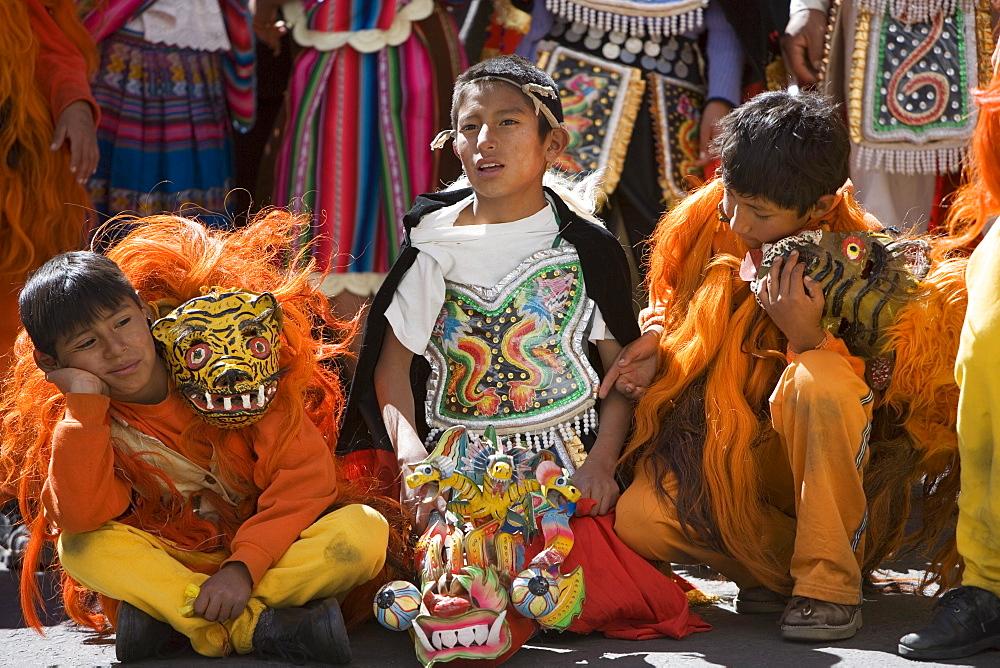 Boys wait for procession, Sucre, Bolivia, South America