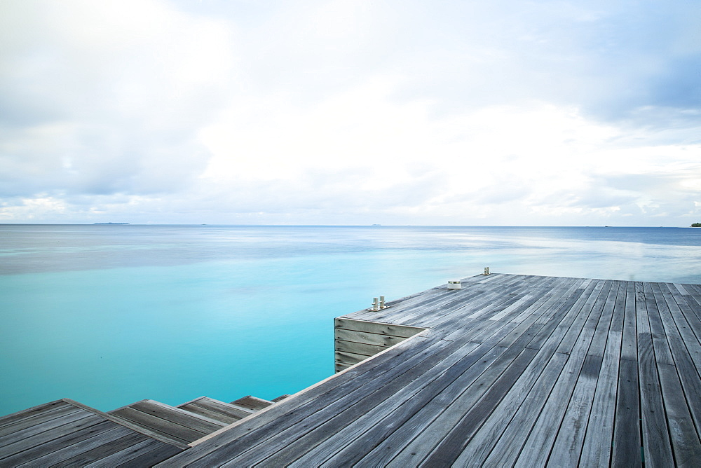 Pier and calm ocean, The Maldives, Indian Ocean, Asia