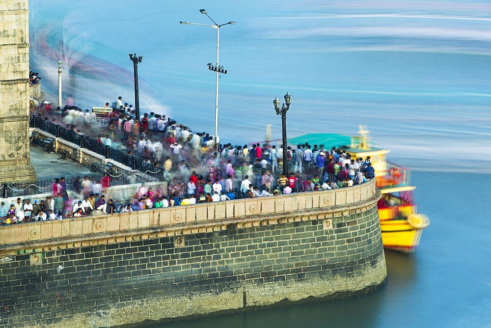 Crowds on waterfront below the Gateway of India, Mumbai, India, Asia