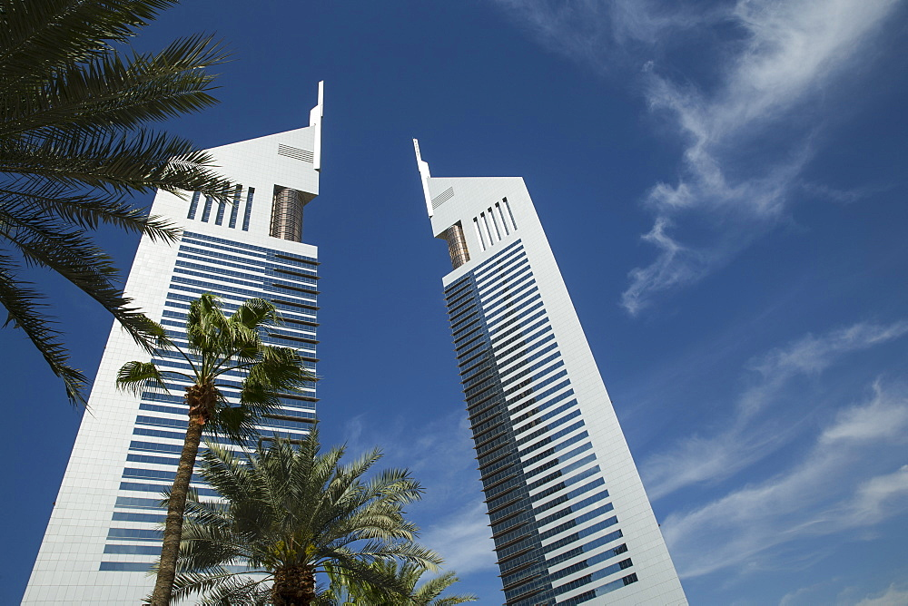 Emirates Towers through palm trees, Dubai, United Arab Emirates, Middle East