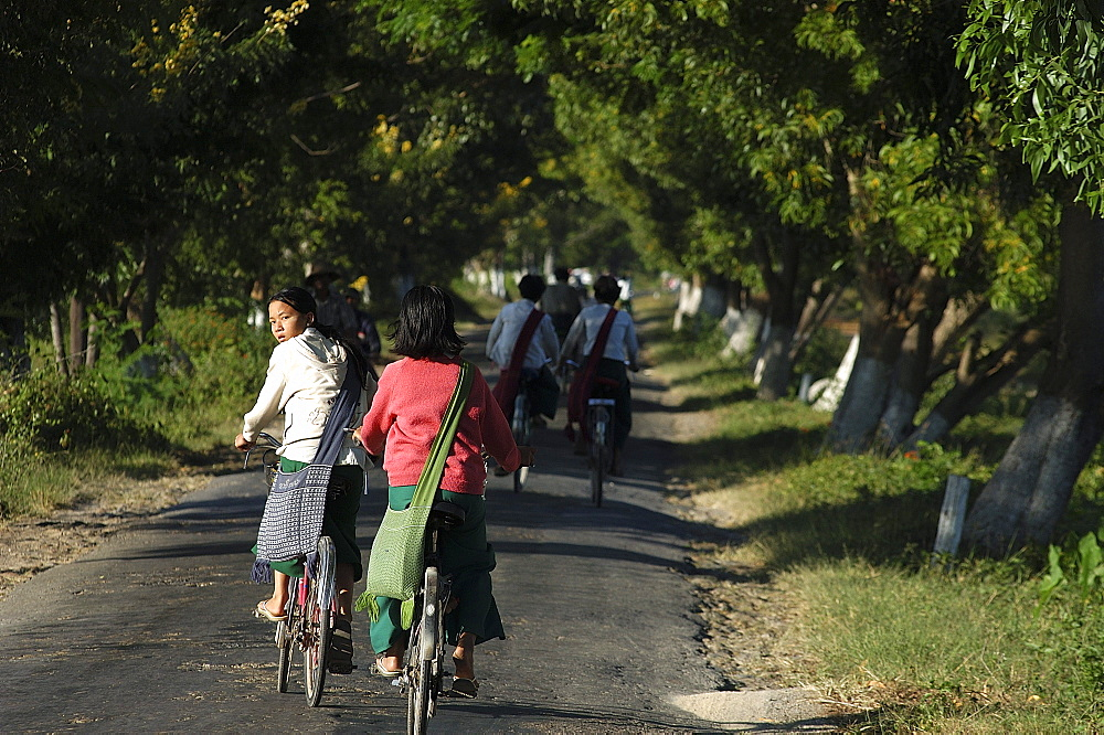 Cycling to school, Inle Lake,Shan State, Myanmar (Burma), Asia