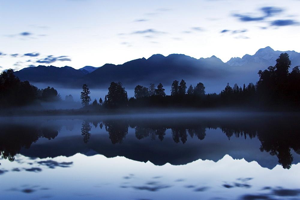 Lake Matheson at night reflecting a near perfect image of Mount Tasman, South Island, New Zealand, Pacific