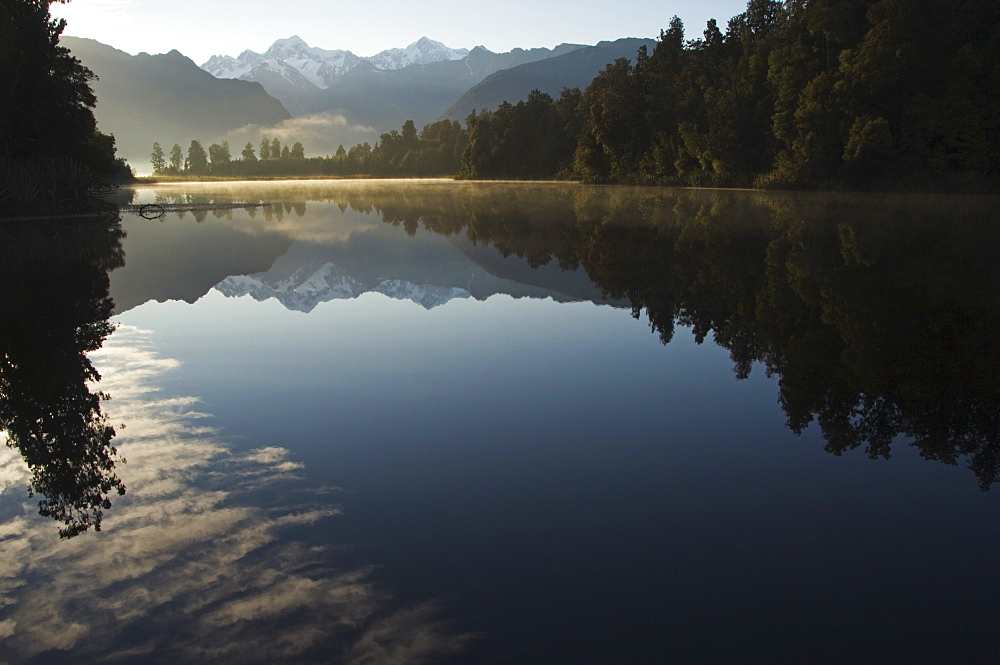 Lake Matheson in the evening reflecting a near perfect image of Mount Tasman and Aoraki (Mount Cook), 3754m, Australasia's highest mountain, South Island, New Zealand, Pacific
