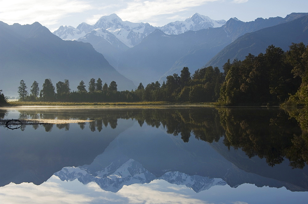 Lake Matheson reflecting a near perfect image of Mount Tasman and Aoraki (Mount Cook), 3754m, Australasia's highest mountain, Southern Alps, South Island New Zealand, Pacific