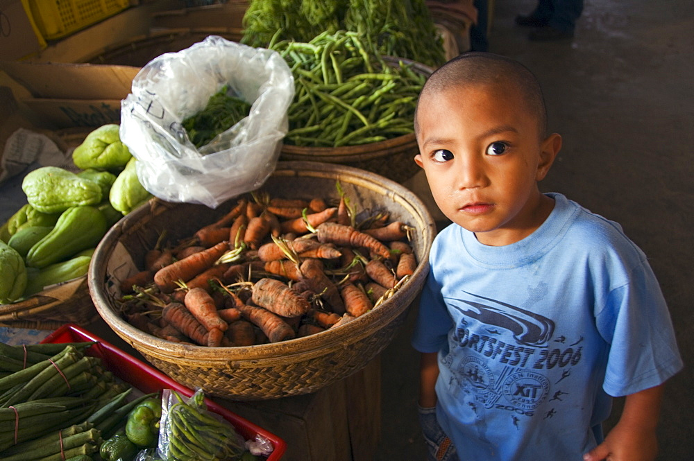 Little boy vendor at vegetable stall in food market, Bontoc, The Cordillera Mountains, Mountain Province, Luzon, Philippines, Southeast Asia, Asia