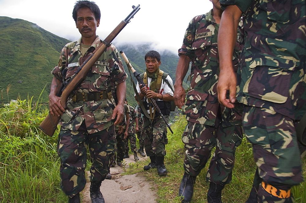 Philippine Army personnel hiking on trail near Tinglayan, The Cordillera Mountains, Kalinga Province, Luzon, Philippines, Southeast Asia, Asia