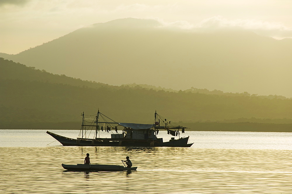 Silhouette of fishing boat at sunset, Puerto Princesa, Palawan, Philippines, Southeast Asia, Asia
