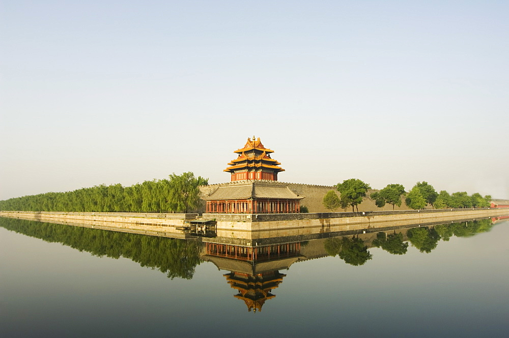 A Reflection Of Palace Wall Tower Surrounded By The Moat Forbidden City