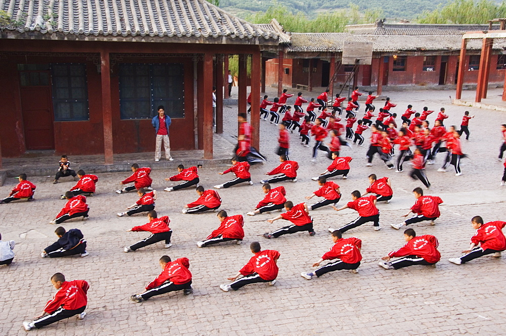Students exercising and training at Wushu Institute at Tagou Training school for kung fu students, Shaolin Monastery, Shaolin, birthplace of Kung Fu martial art, Henan Province, China, Asia